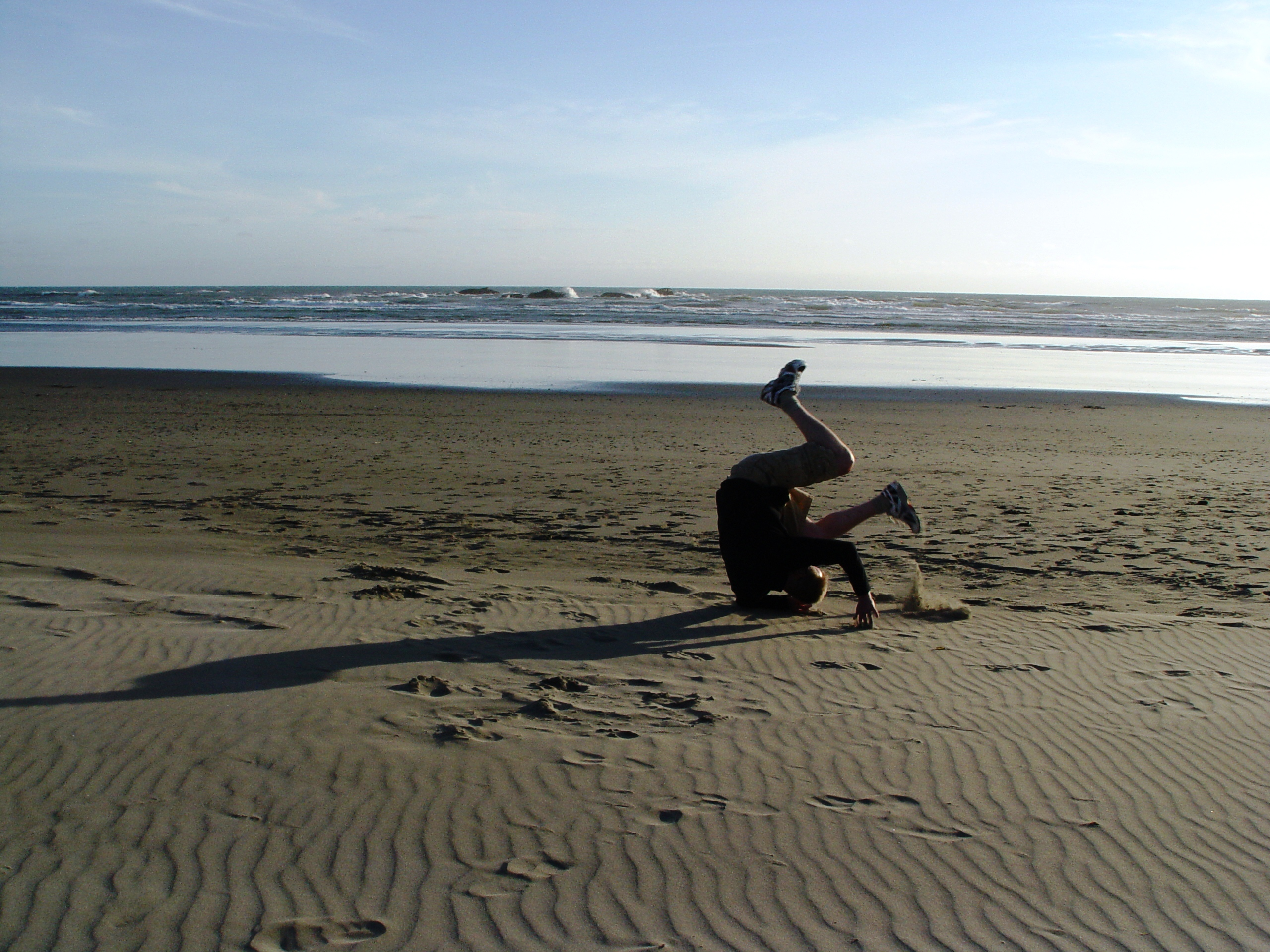 Hakan tumbling on a beach