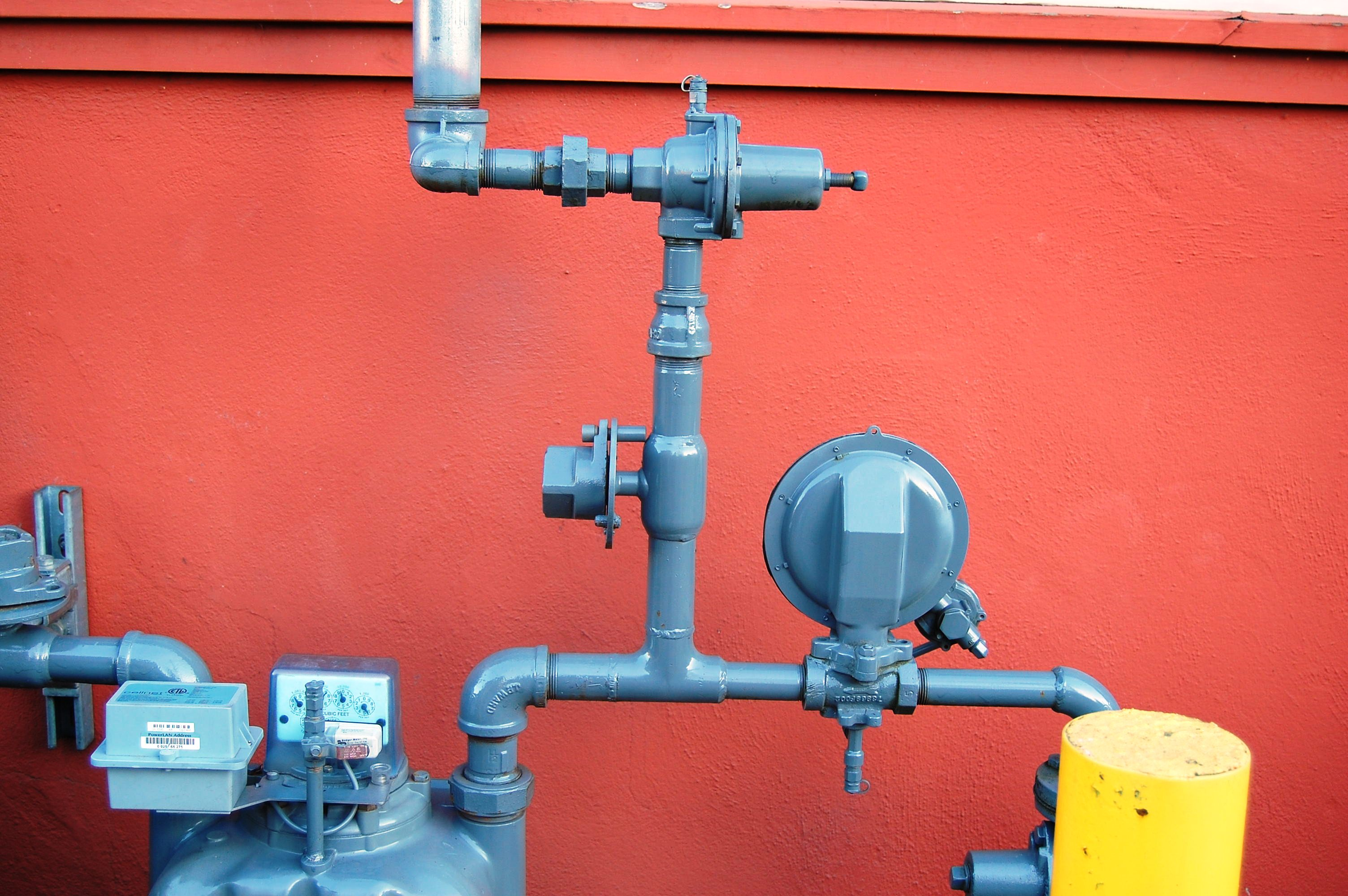Gray pipes against an orange/red background