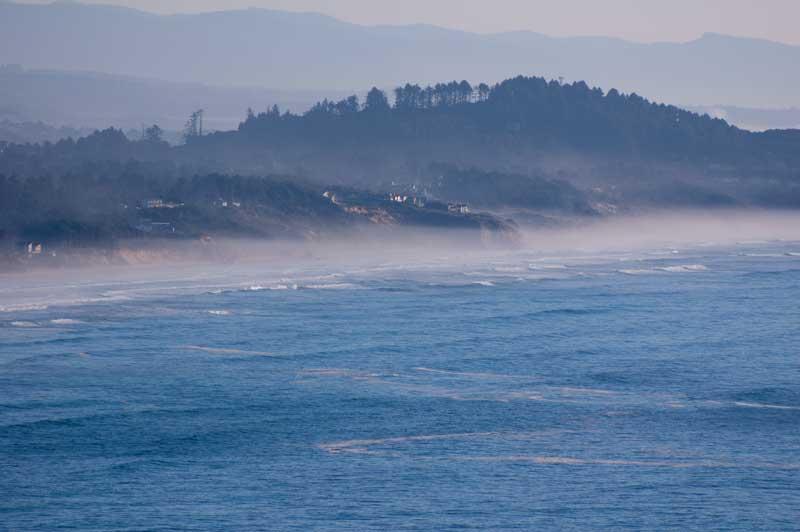 A soft mist showing along a beach